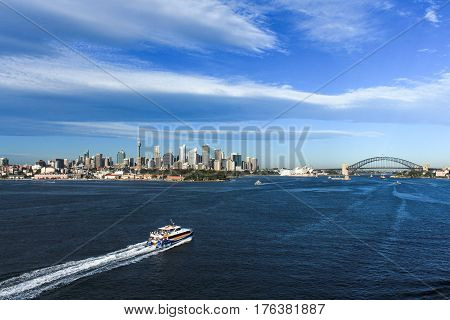 Sydney Harbour Australia including city skyline, bridge and boats