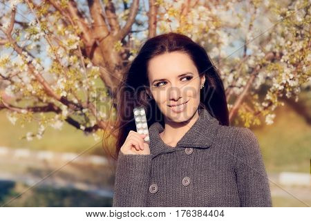 Confident Woman Holding Her Pills Fighting Spring Allergies