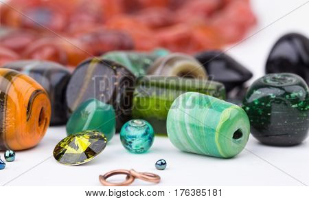Semi-precious stone beads for making jewelry. Selective focus.