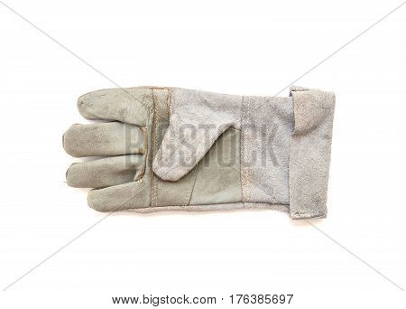 Closeup old fabric glove for construction worker isolated on white background