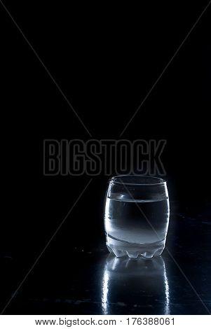 Wineglass Frozen Vodka On Black Background
