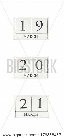 Closeup group of white wooden calendar with black 19 20 21 march word three date calendar isolated on white background