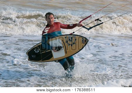 SAN BENEDETTO DEL TRONTO - MARCH 10, 2017: Tired kitesurfer go out from the sea