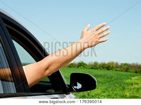 Man inside car showing his hand outdoor