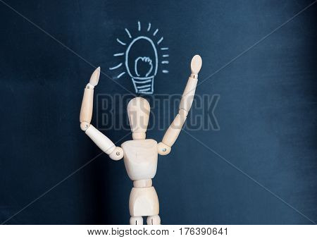wooden puppet on a black background. The concept is a new idea