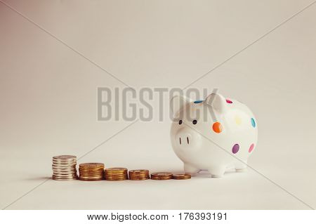 White piggy bank or money box with money coins