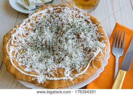 Fried cake with cheese and garlic sauce with orange napkin