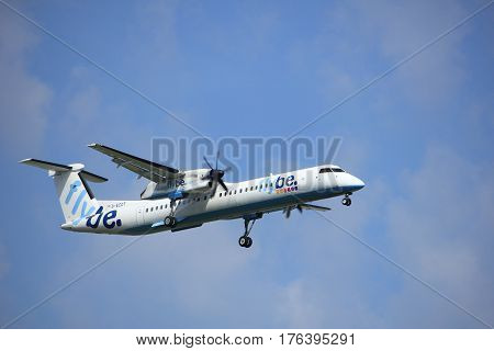 Amsterdam the Netherlands - July 21st 2016: G-ECOT Flybe De Havilland Canada DHC-8 approaching Polderbaan runway at Schiphol Amsterdam Airport arriving from Southampton United Kingdom