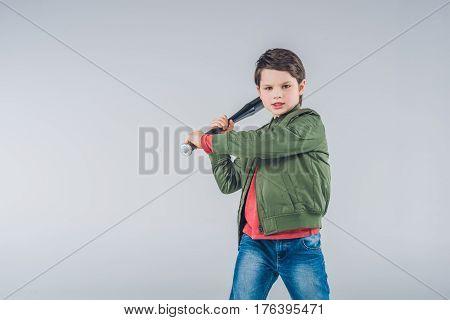 Boy Brandishing Baseball Bat Standing On Gray