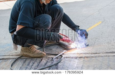 Man work with welding helmet welding steel