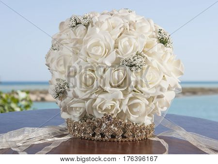 Brides Bouquet Bunch Of Flowers And Tiara On Table