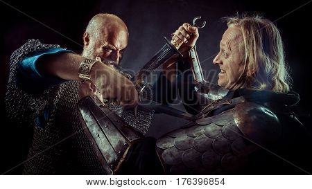 Dagger Fight Between Two Medieval Knights On The Dark Background