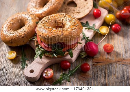 Vegetarian bagel sandwich with fresh veggies and arugula vegan healthy food lunch breakfast snack