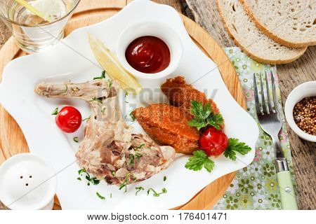 Boiled rabbit vegetable puree and tomato sauce concept of healthy food