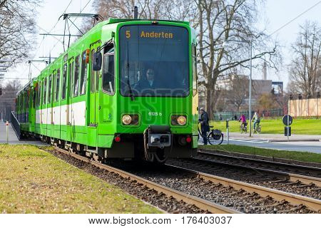 HANNOVER / GERMANY - MARCH 12 2017: german tram from UESTRA drives to the next stop. UESTRA is the operator of public transport in the city of Hanover Germany