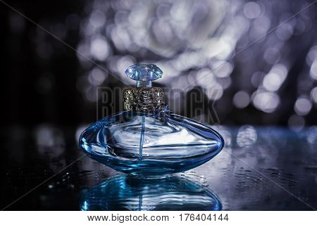 stylish bottle of Female perfume over blue