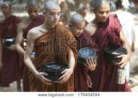 Monks Going for Lunch at Kalaywa Tawya Monastery in Yangon. February 23 2014 - Yangon Myanmar