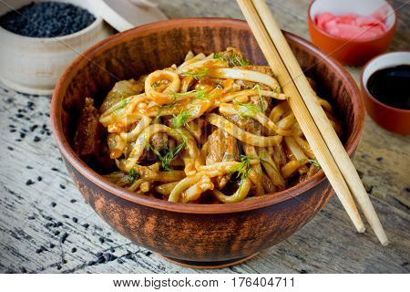 Udon noodles with meat pork in sauce traditional Japanese cuisine selective focus