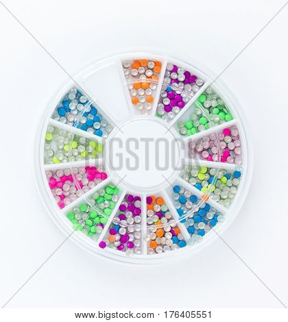 Colorful neon nail glitters isolated on white background