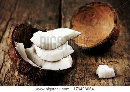 Coconut on dark wooden background selective focus