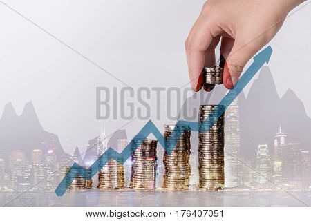 Hand Put Money Coins To Stack Of Coins, Money, Financial, Business Growth And Saving Money Concept.