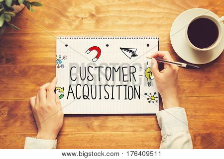 Customer Acquisition Text With A Person Holding A Pen