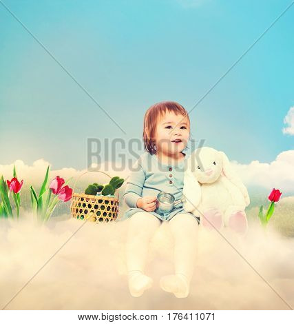 Toddler girl with white bunny in spring day