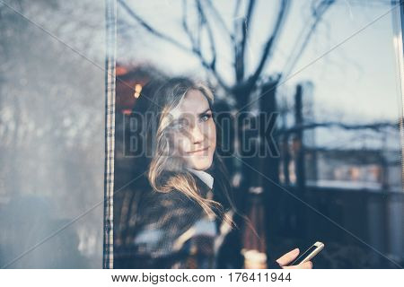 The Woman Looked Out The Window Of The Cafe.