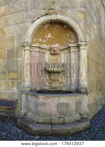 Detail of the old decorative drinking fountain