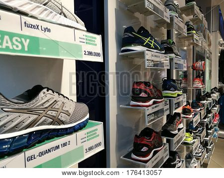 Hanoi, Vietnam - Mar 3, 2017: View of the fỉrst Asics sport footwear store in Hanoi capital. It is a Japanese multinational corporation athletic equipment which produces footwear and sports equipment.