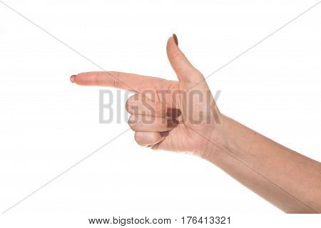 A brush of a female hand shows a symbol. Beautiful and graceful female hand on a white background shows different gestures.
