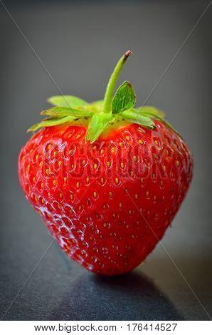 Strawberry fruit isolated on black background, close up