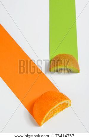 Kiwi and orange fruit sliced and path on white background