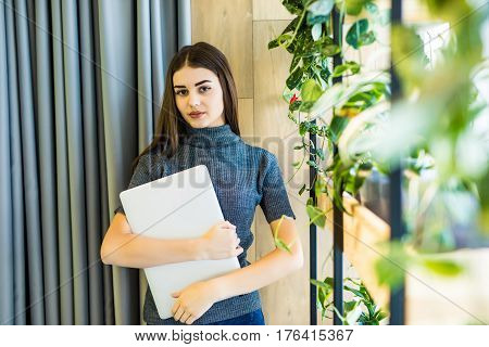 Business Woman With Laptop In His Hands. Good Worker In Office.