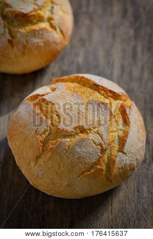 traditional homemade round bread on wooden table