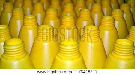 Yellow plastic bottles. Photo of plastic bottles