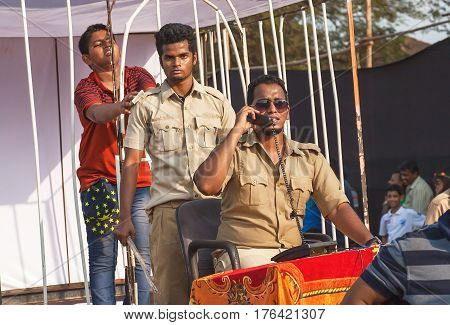 PANJIM, INDIA - FEB 25, 2017: Teenager imprisoned in a cell by actors in uniform playing corruption police department at Goa carnival on February 25, 2017. Carnaval is celebrated in Goa since 18th century