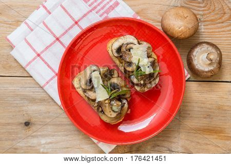 Bruschetta With Mushrooms On A Wooden Board