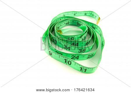 The green measuring tape on the white background