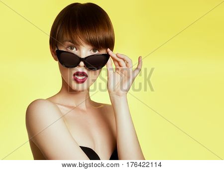 Beauty Surprised Fashion Funny Model Girl Wearing Sunglasses. Young Girl. Expressing Positive Emotio