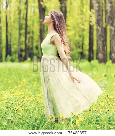Young woman in the forest is relaxing