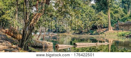 Beautiful lake near Preah Khan Temple in Siem Reap, Cambodia. Preah Khan has been left largely unrestored with trees and other vegetation growing among the ruins. Selective focus