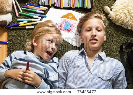 Picture of brothers having fun in the floor