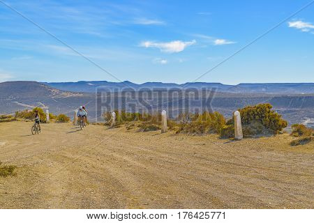 CHUBUT, ARGENTINA, MARCH - 2016 - Group of sport women riding bicycle at top of hill in a sunny day at Punta del Marquez Chubut Argentina