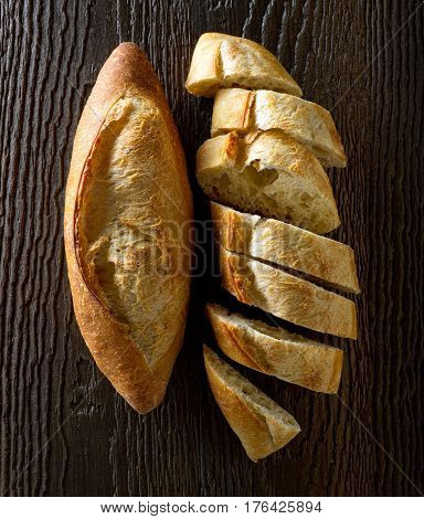 Freshly baked french bread baguettes on a rustic wood table.
