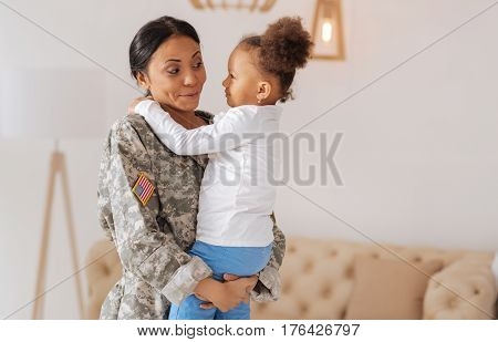 You will not believe. Emotional bright happy mother saying how much she missing her little princess and holding her tight in her arms