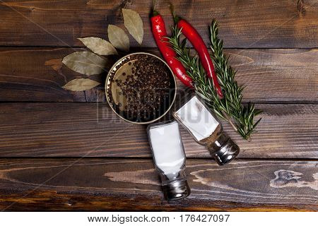 Red Chili Pepper And Rosemary Sprigs With Laurel Leaves And Pepper Black Peas In A Jar, Shaker Cans