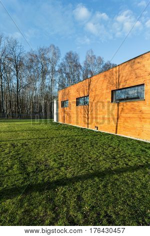 Cuboid Wooden House Near Forest