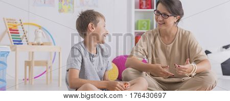 Psychotherapist Discussing With A Boy