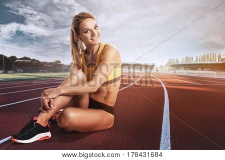 Sport. Runner. Young Sportswoman Preparing To Run. Stadium